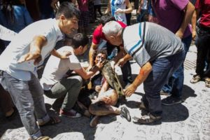 epa04854185 People try to help wounded people after an explosion at a cultural center in Suruc, Sanliurfa province, Turkey, 20 July 2015. At least 20 people were killed and some 100 wounded in a suicide blast ouside a cultural centre in Suruc, Sanliurfa province. The incident took place in Suruc, across from northern Syria town Kobane, which was the scene of heavy battles earlier this year between Kurdish fighters, backed by United States-led airstrikes, and the Islamic State extremist group. Nearlt at the same time, casualties were reported in a car bombing in Kobane near a checkpoint close to the Syrian-Turkish border.  EPA/DEPO PHOTOS ATTENTION EDITORS: PICTURE CONTAINS GRAPHIC CONTENT ; TURKEY OUT