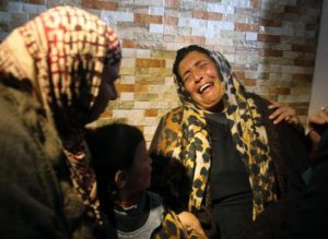 epa04510831 The mother (R, no name given) of suspected Palestinian attacker Amal Taqatqa is crying in her home in the West Bank village of Fajar, south of Bethlehem, 01 December 2014 after she learned her daughter had been shot and seriously wounded by an Israeli soldier after Amal allegedly had stabbed an Israeli at the Gush Etzion interchange in the West Bank, not far from the village. Israeli forces ransacked the house of Amal Taqatqa after the attack.  EPA/ABED AL HASHLAMOUN