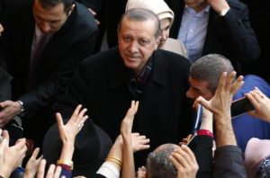 Turkey's President Recep Tayyip Erdogan, centre, looks up as he leaves a polling station, in Istanbul, Sunday, Nov. 1, 2015. Turks headed to the polls Sunday for the second time in five months in what is being seen as a crucial general election that will determine whether the ruling party can restore the parliamentary majority it enjoyed for the past 13-years. (ANSA/AP Photo/Emrah Gurel)