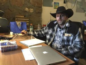 Ammon Bundy sits at a desk he's using at the Malheur National Wildlife Refuge in Oregon on Friday, Jan. 22, 2016. Bundy is the leader of an armed group occupying a national wildlife refuge to protest federal land policies. The leader of an armed group occupying the refuge met briefly with a federal agent Friday, but left because the agent wouldn't talk with him in front of the media. (ANSA/AP Photo/Keith Ridler)