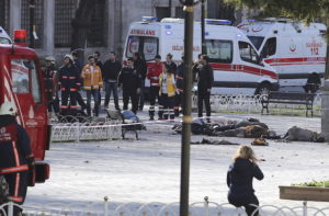 ATTENTION EDITORS - VISUALS COVERAGE OF SCENES OF DEATH OR INJURY Rescue teams gather at the scene after an explosion in central Istanbul, Turkey January 12, 2016. Turkish police sealed off a central Istanbul square in the historic Sultanahmet district on Tuesday after a large explosion, a Reuters witness said, and the Dogan news agency reported several people were injured in the blast. REUTERS/Kemal Aslan TPX IMAGES OF THE DAY TEMPLATE OUT. - RTX21Z5B