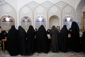 Iranian women vote in the parliamentary and Experts Assembly elections at a polling station in Qom, 125 kilometers (78 miles) south of the capital Tehran, Iran, Friday, Feb. 26, 2016. Iranians across the Islamic Republic voted Friday in the country's first election since its landmark nuclear deal with world powers, deciding whether to further empower its moderate president or side with hard-liners long suspicious of the West. The election for Iran's parliament and a clerical body known as the Assembly of Experts hinges on both the policies of President Hassan Rouhani, as well as Iranians worries about the country's economy, long battered by international sanctions. (ANSA/AP Photo/Ebrahim Noroozi)