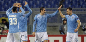 Lazio's Miroslav Klose, center, celebrates with teammates after scoring during the second leg of the UEFA Europa League round of 32 soccer match between Lazio and Galatasaray, at Rome's Olympic stadium, Thursday, Feb. 25, 2016. (AP Photo/Gregorio Borgia)