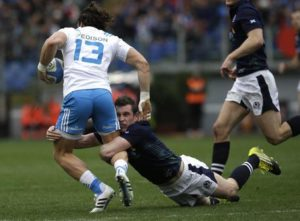Italys Michele Campagnaro, left, and Scotlands Mark Bennett compete for the ball during a Six Nations rugby union international match between Italy and Scotland, in Rome, Saturday, Feb. 27, 2016. (ANSA/AP Photo/Alessandra Tarantino)