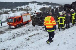 epa05152515 An image showing French rescue personnel at the site of an accident, after two children died in a French school bus crash early 10 February 2016 in Montflovin in the Doubs département of north-eastern France. The crash occurred at 7.40am amid wintery conditions. EPA/WILLY GRAFF FRANCE OUT, SWITZERLAND OUT, CORBIS OUT