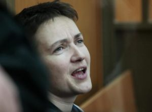 Ukrainian pilot Nadezhda Savchenko speaks in a glass cage inside court, in the town of Donetsk, Rostov-on-Don region, Russia, Tuesday, March 22, 2016. The Ukrainian pilot who is charged with complicity to murder in the deaths of two Russian journalists in war-torn eastern Ukraine has arrived to court in southwestern Russia where the verdict in her trial is due to continue. Nadezhda Savchenko served in a volunteer battalion against Russia-backed rebels and was captured by separatist rebels in July 2014 before she surfaced in Russia. (ANSA/AP Photo/Ivan Sekretarev)