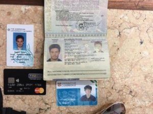 FILE -- In this file photo released by the Egyptian Ministry of Interior on Thursday, Mar. 24, 2016, personal belongings of slain Italian graduate student Giulio Regeni, including his passport, are displayed. On Sunday, April 3, 2016 the editor of Egypt's top state newspaper called on Egyptian authorities to seriously deal with the case of an Italian student tortured and killed in Cairo, saying officials who didn't realize the gravity of the case are risking Egyptian-Italian relations. Italian Premier Matteo Renzi has insisted Italy will settle for nothing less than the truth. (Egyptian Interior Ministry via AP, File)