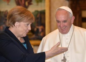 German Chancellor Angela Merkel (L) with Pope Francis during a private audience on May 6, 2016 at the Vatican. Merkel is in Rome to take part in a ceremony for the awarding of Germany's famed Charlemagne Prize to Pope Francis, given to public figures in recognition of contribution to European unity. ANSA/ ALBERTO PIZZOLI/AFP/POOL