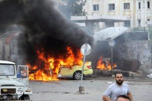 epa05324728 A handout photograph released by the official Syrian Arab News Agency (SANA) shows flames rising following a bombing at a bus station in the coastal city of Tartus, Syria, 23 May 2016. According to SANA, at least 20 people were killed in three bombings targeting bus station and a residential suburb in front of the bus station in Tartous. Some 45 people were also killed in a series of bombings in Jableh city. EPA/SANA HANDOUT HANDOUT EDITORIAL USE ONLY/NO SALES
