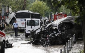 epa05349396 A general view shows police officers inspecting the site of a bomb attack to a police bus in the Vezneciler district of Istanbul, Turkey, 07 June 2016. At least five people were wounded after an explosion, caused by a bomb, targeted a police bus, local media reported. EPA/SEDAT SUNA