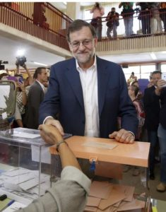 Acting Spanish Prime Minister, Mariano Rajoy, greets an electoral member upon his arrival to vote in the general elections at a polling station Madrid, Spain, 26 June 2016. EPA/ANGEL DIAZ