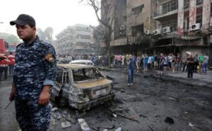 epa05404942 Iraqis gather at the site of suicide car bomb attack in the Karada district of central Baghdad, Iraq, 03 July 2016. At least 23 people were killed and 70 others were wounded in a suicide car bomb attack targeted Karada district of Baghdad and other attack by a roadside bomb in Shaab market , Iraqi police said. EPA/ALI ABBAS