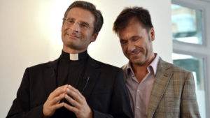 "Father Krysztof Olaf Charamsa (L), who works for a Vatican office, gives a press conference with his partner Edouard to reveal his homosexuality on October 3, 2015 in Rome. The priest said he wanted to challenge what he termed the Church's ""paranoia"" with regard to sexual minorities, claiming the Catholic clergy was largely made up of intensely homophobic homosexuals. The Vatican condemned the coming out of a Polish priest on the eve of a major synod as a ""very serious and irresponsible,"" act which meant he would be stripped of his responsibilities in the Church's hierarchy. In a statement, a spokesman said Krzystof Charamsa would not be able to continue in his senior position in the Vatican and that his future as a priest would be decided by his local bishop. AFP PHOTO / TIZIANA FABI (Photo credit should read TIZIANA FABI/AFP/Getty Images)"
