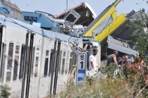 Rescue tems at the site of the head-on train collision between the towns of Andria and Corato in the southern Puglia region, Italy, 12 July 2016. The crash, that took place on a single-track stretch, has left at least 20 dead. ANSA/ LUCA TURI
