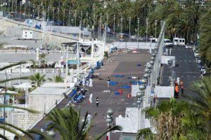 epa05425806 Crime scene investigators work on the 'Promenade des Anglais' after the truck crashed into the crowd during the Bastille Day celebrations in Nice, France, 15 July 2016. French government announce a three days of national mourning after the attack in Nice. According to reports, at least 84 people died and many were wounded after a truck drove into the crowd on the famous Promenade des Anglais during celebrations of Bastille Day in Nice, late 14 July. Anti-terrorism police took over the investigation in the incident, media added. EPA/OLIVIER ANRIGO