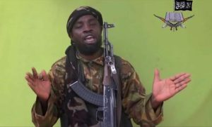 FILE - In this Monday May 12, 2014 file photo taken from video by Nigeria's Boko Haram terrorist network, shows their leader Abubakar Shekau speaking to the camera. the The military said Tuesday, Aug. 23, 2016, that Boko Haram leader Abubakar Shekau is believed to have been fatally wounded in an airstrike while he was praying in a forest stronghold in northeast Nigeria. (ANSA/AP Photo/File)