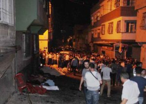 People gather after an explosion in Gaziantep, southeastern Turkey, early Sunday, Aug. 21, 2016. Gaziantep Province Gov. Ali Yerlikaya said the deadly blast, during a wedding near the border with Syria, was a terror attack. (Eyyup Burun/DHA via AP)e [CopyrightNotice: DHA]
