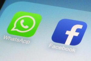 FILE - This Feb. 19, 2014, file photo, shows WhatsApp and Facebook app icons on a smartphone in New York. WhatsApp says on Tuesday, April 5, 2016,  it's now using a powerful form of encryption to protect the security of photos, videos, group chats and voice calls in addition to text messages sent by more than a billion users around the globe. (ANSA/AP Photo/Patrick Sison, File)