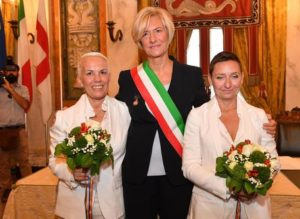 Italian Defense minister Roberta Pinotti, center, after the civil ceremony of marriage between two women - Pamela, right, and Elizabeth, left - at Tursi Palace in Genoa, Italy, October 8, 2016. ANSA/ LUCA ZENNARO