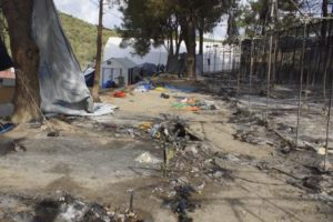epa05548945 Burnt tents following clashes between groups of refugees and migrants of different nationalities at the camp of Moria on Lesvos (Lesbos) island, Greece, 20 September 2016. Migrants set fire to several parts of the camp which then spread causing hundreds of people to flee. Authorities evacuated the area where unaccompanied minors were living and transferred them to a new facility. Earlier today, rumours that mass returns to Turkey were imminent prompted renewed incidents and a break-out from the hotspot who attempted to set off on a protest march to Mytilene, the island's main town, but were stopped and forced to turn back by police.  EPA/STRATIS BALASKAS