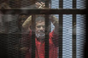 epa05601759 YEARENDER 2016 JUNE Ousted Egyptian President Mohamed Morsi looks on during a trial session on charges of espionage in Cairo, Egypt, 18 June 2016. A court sentenced ousted president Mohamed Morsi to life in prison as well as a 15-year prison sentence over charges of allegedly leaking classified documents related to national security to Qatar in exchange for payments. The court also confirmed death sentences against six co-defendants in the case.  EPA/MOHAMED HOSSAM