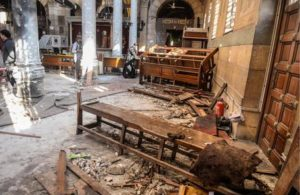 epa05670929 People inspect the damage inside the St. Peter and St. Paul Coptic Orthodox Church following a bombing in Cairo, Egypt, 11 December 2016. Reports state at least 25 people were killed and 35 injured on 11 December 2016 in an explosion outside Cairo's Coptic Cathedral in the Abbassia neighborhood. Local media quoting security and Church officials said the explosion occurred in the St. Peter and St. Paul Coptic Orthodox Church, a small chapel attached to the Coptic Cathedral. EPA/MOHAMED HOSSAM
