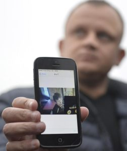 Ariel Zurawski, the owner of a Polish trucking company, shows the last photo taken of his cousin and driver, Lukasz Urban, who was apparently the first victim of the attack in Berlin on Monday, in Sobiemysl, Poland, on Tuesday, Dec. 20, 2016. The attacker apparently hijacked Urban's truck and stabbed and shot the Poles to death before driving the truck into the Christmas market.(ANSA/AP Photo) [CopyrightNotice: Copyright 2016 The Associated Press. All rights reserved.]