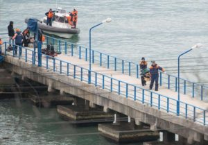 epa05687865 Rescuers unload fragments and remains from a boat, found at the site of the Tu-154 plane crash near Sochi, Russia, 25 December 2016. According to media reports, a Tupolev-154 Russian airplane carrying at least 92 people disappeared from radar and crashed into the Black Sea after taking off from an airport in Sochi on 25 December. The plane which was flying to Latakia, Syria, was reportedly carrying 65 members of the Alexandrov Ensemble, eight crew members, nine Russian journalists as well as Russian civil activist, Doctor Yelizaveta Glinka (Doctor Liza). EPA/YEVGENY REUTOV