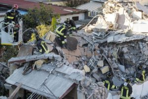 Fire fighters at work in Acilia, on the southern outskirts of Rome, where a two-story building collapsed today, Wednesday, probably because of a gas leak. Two people, a man and a woman, were pulled alive from the rubble. Rome, Italy, Dec. 28, 2016. ANSA/ MASSIMO PERCOSSI