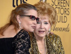 epa05690440 (FILE) - A file picture dated 25 January 2015 shows US actresses Debbie Reynolds (R) and her late daughter Carrie Fisher (L) posing at the 21th Annual Screen Actors Guild Awards ceremony at the Shrine Auditorium in Los Angeles, California, USA. According to media reports on 28 December 2016, US actresses Debbie Reynolds died at the age of 84 at a hospital in Los Angeles on 28 December, one day after her daughter Carrie Fisher, known for her Princess Leia role in Star Wars series, died after suffering a heart attack. EPA/PAUL BUCK