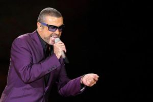 epa05688222 (FILE) - A file picture dated 05 October 2012 shows British singer George Michael performing songs from his Symphonica Tour at the Motorpoint Arena, Cardiff, south Wales, Britain. According to reports on late 25 December 2016, British popstar George Michael has died peacefully at home at the age of 53, his publicist has announced. EPA/GEOFF CADDICK