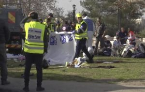 This frame grab from video, shows Israeli emergency services personnel covering bodies with plastic sheets at scene of a truck-ramming attack in Jerusalem that killed at least four people and wounded several others in Jerusalem, Sunday, Jan. 8, 2017. Israeli police and rescue services said a Palestinian rammed his truck into a group of Israeli soldiers in one of the deadliest attacks of a more than yearlong campaign of violence. Security camera footage shows the truck barreling at a high speed off the road and into a crowd of people in the Armon Hanatziv neighborhood. (ANSA/AP Photo) [CopyrightNotice: Copyright 2017 The Associated Press. All rights reserved.]