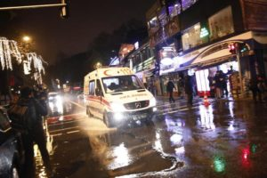 An ambulance rushes from the scene of an attack in Istanbul, early Sunday, Jan. 1, 2017. Turkey's state-run news agency said an armed assailant has opened fire at a nightclub in Istanbul during New Year's celebrations. (ANSA/AP Photo/Halit Onur Sandal) [CopyrightNotice: Copyright 2017 The Associated Press. All rights reserved.]